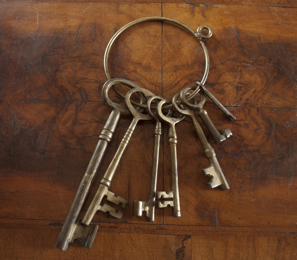 Antique skeleton keys with wood background.